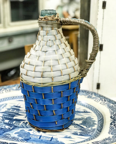 Early 20th century Hungarian Wine Demi John in original woven basket