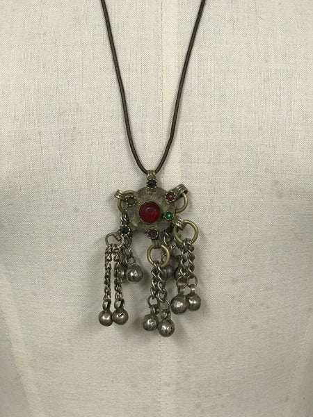 Original antique Afghan tasseled pendant on leather cord.