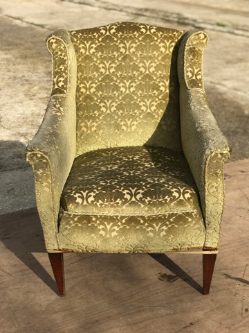 Edwardian 'Hers' fireside wing chair.