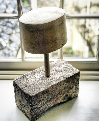 Early 20th century Milliners Hat Block on antique base.