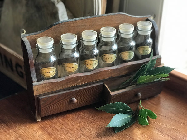 1950's French a spice rack with original bottles and stoppers.