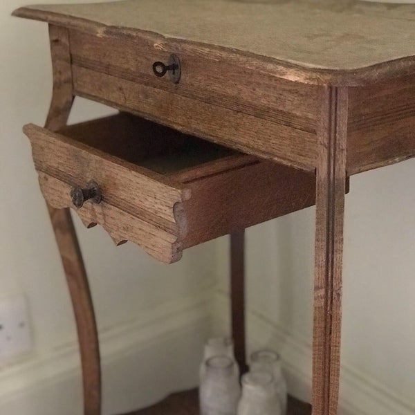 Early 20th century French oak vanity table with drawer.