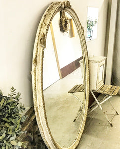 Stunning early 19th century Carved Wood Oval Frame with mirror plate.