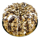 Caramel Pecan Marshmallow Popcorn Cake with Chocolate Drizzle