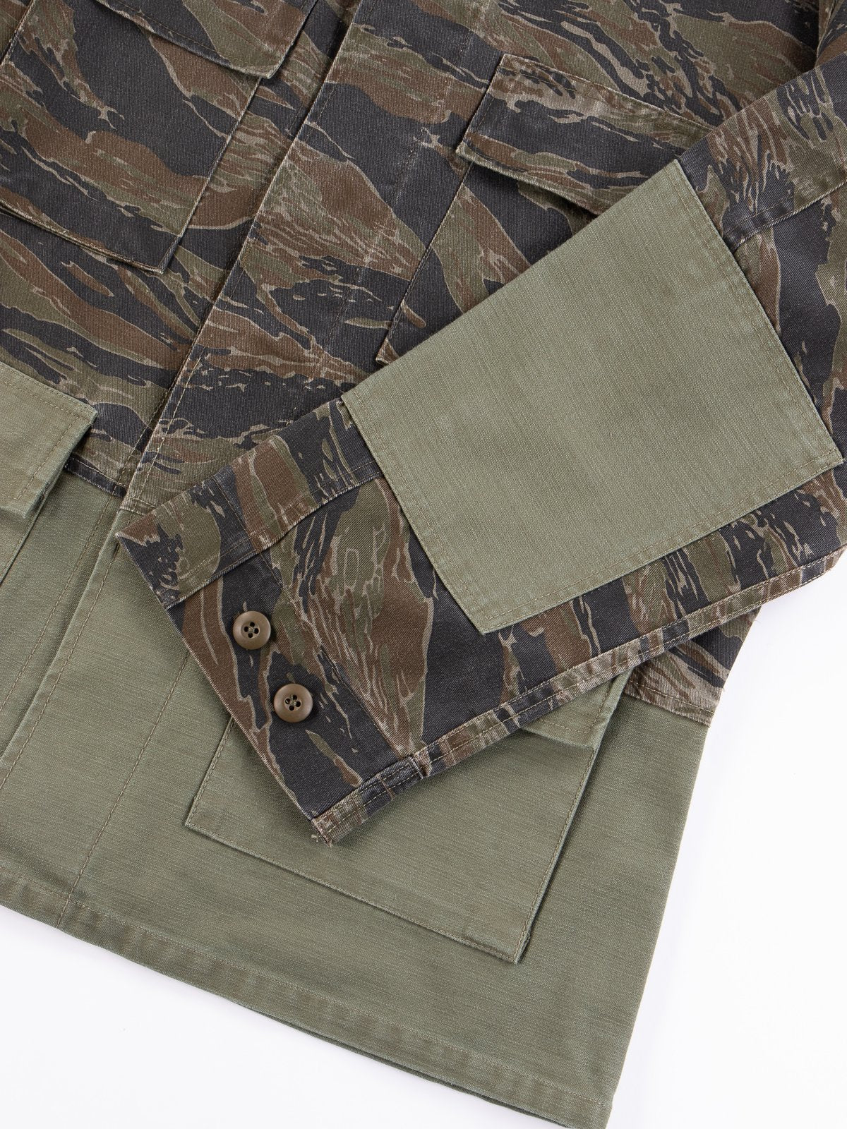 Close-up image of a Universal Works camouflage and japanese cotton twill jacket.