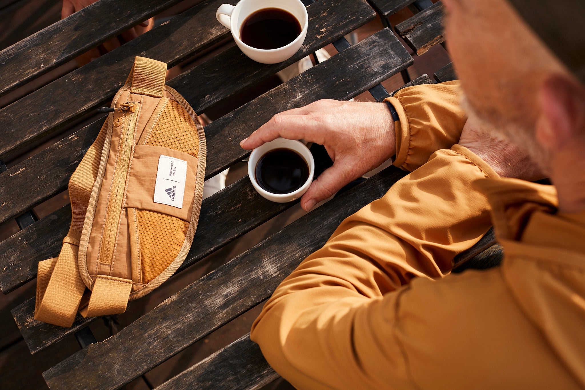 Universal Works x adidas bum bag with a coffee.