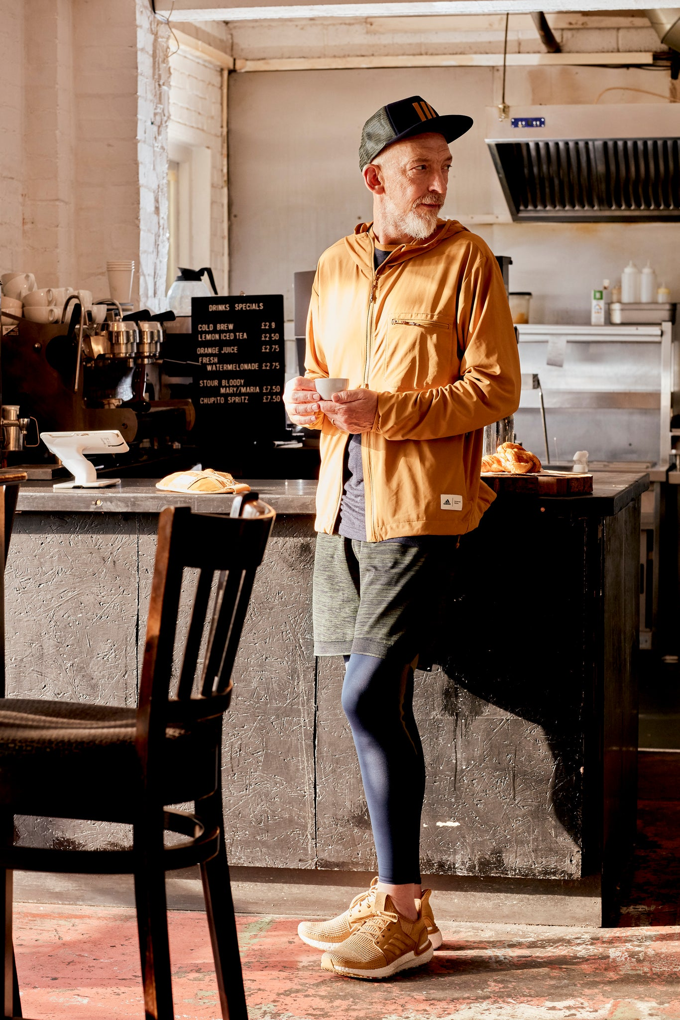 UW designer David Keyte wearing Universal Works x adidas running clothes in a coffee shop.