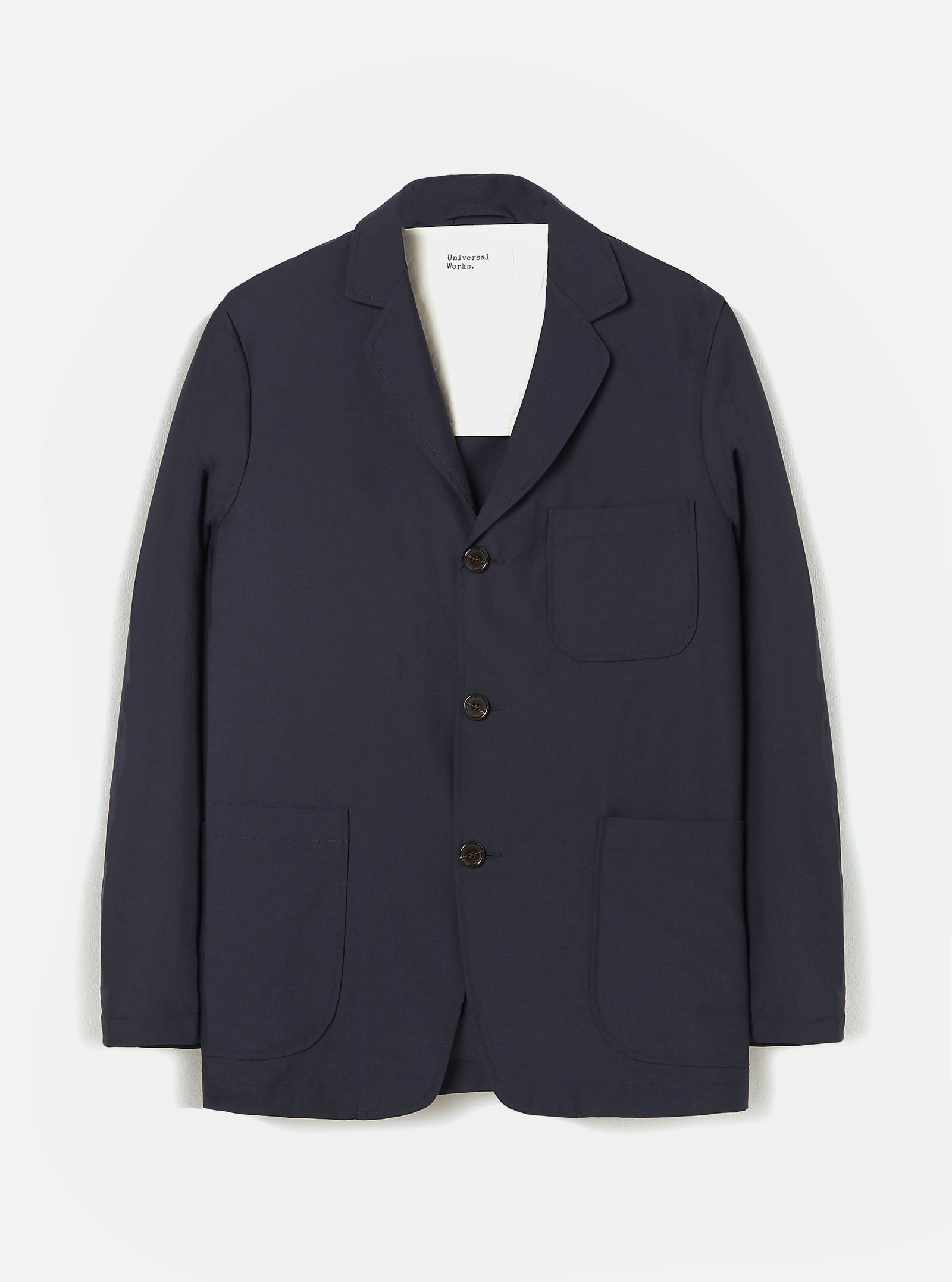 Universal Works Three Button Jacket in Navy Tropical Suiting