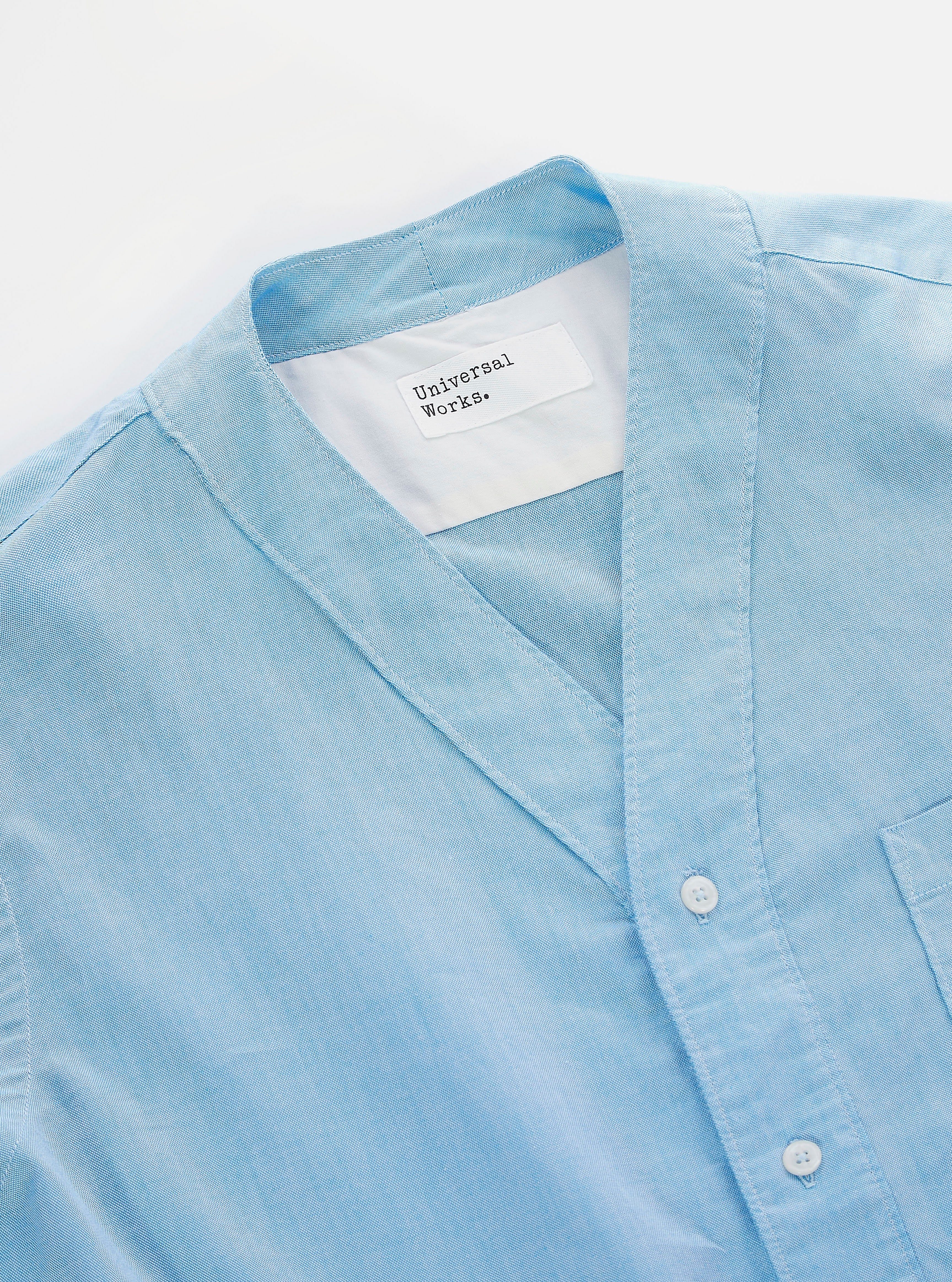 Universal Works S/S V Neck Shirt in Blue Organic Oxford