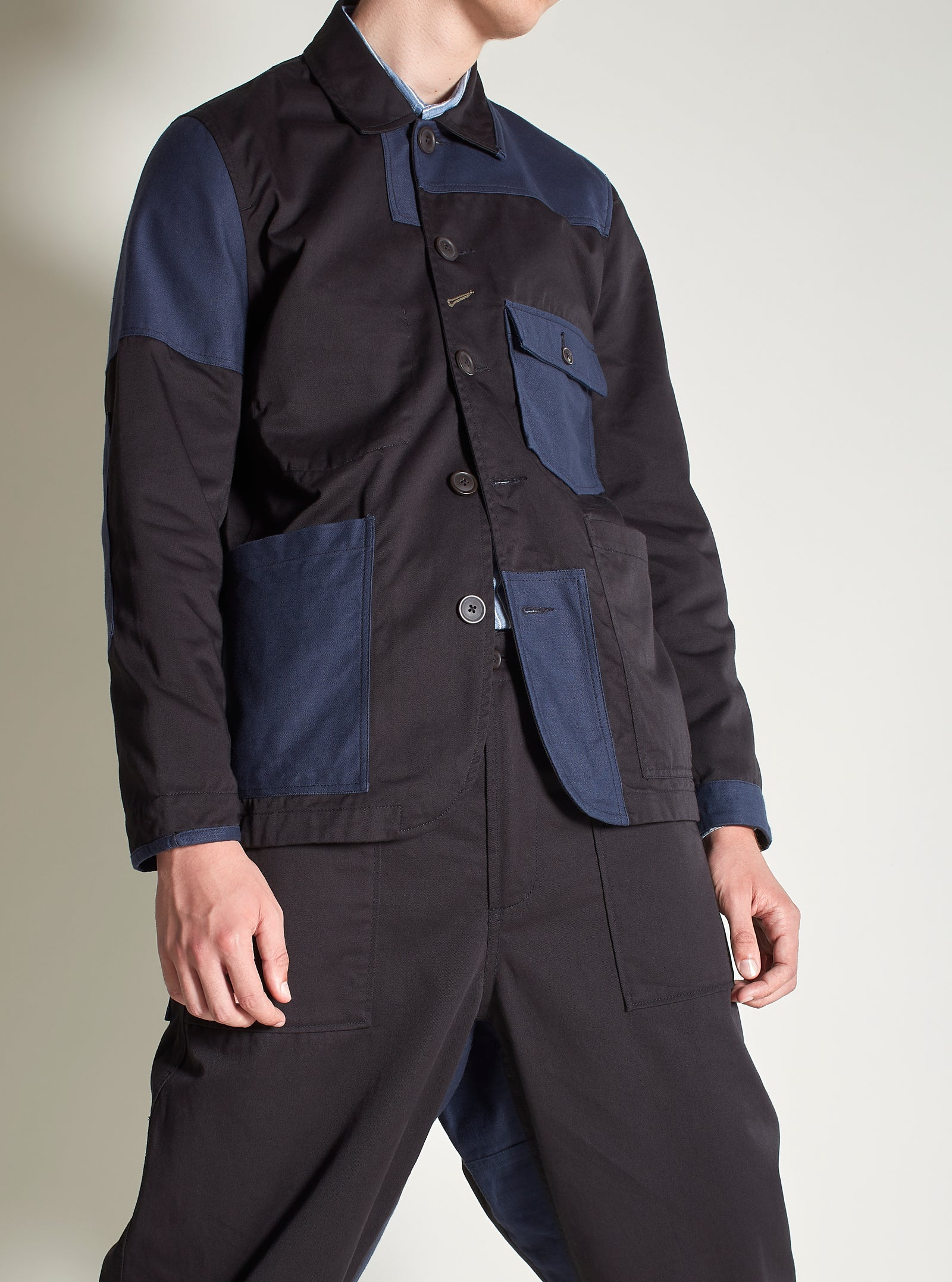 Universal Works Patched Mill Bakers Jacket in Black/Navy Twill Mix