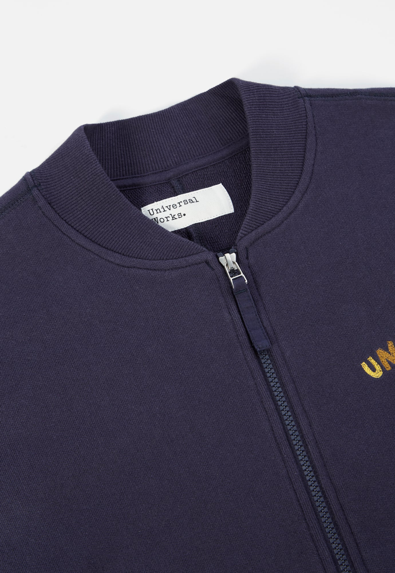 Universal Works Embroidered Carbis Jacket in Navy Loopback