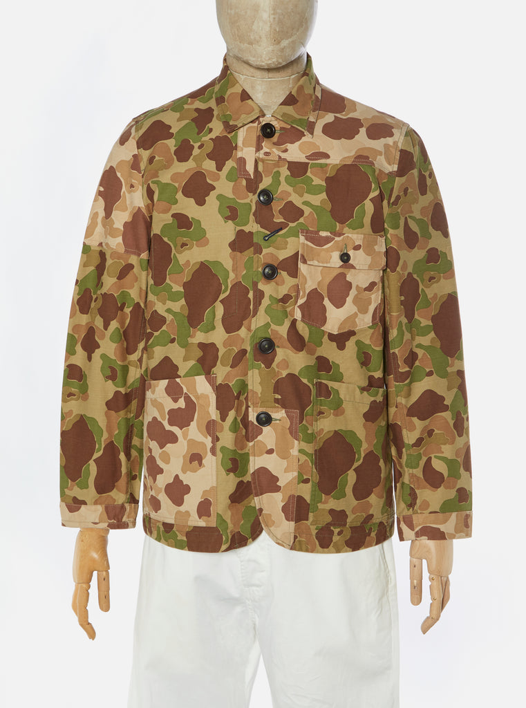 Universal Works Patched Mill Bakers Jacket in Olive/Sand Peacekeeper Camo