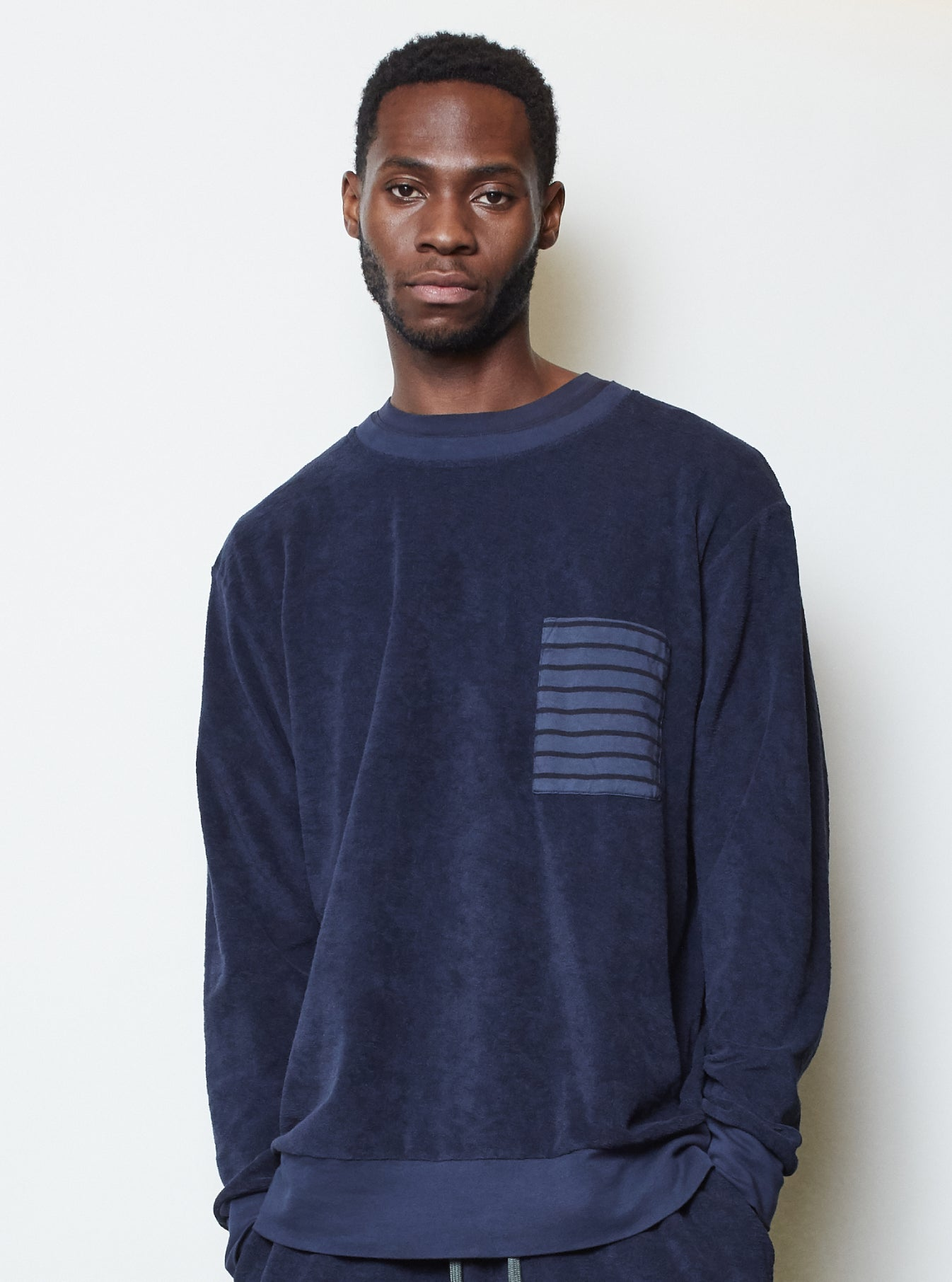The Pilgrm x Universal Works Loose Pullover in Navy Terry Fleece