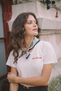 Ma chérie is our tribute to all lovers this season. Crafted in cotton with a soft texture and with a scooped neckline, this fitted t-shirt is a refreshing take on an everyday basic.  Playing the role of both statement and staple in our signature off-white, this piece will be the most worn item in your wardrobe, that will underline your curves in the softest way.