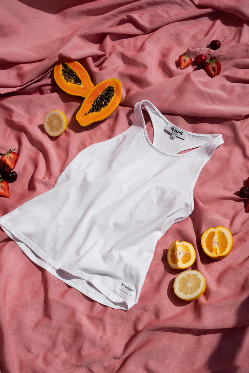 A true classic for every Summer, the white tank top in organic cotton calls out for beach days and late afternoon sunsets. Crafted in a super comfy lightweight cotton jersey, it has a high rounded neckline and a racer back has a straight silhouette for an easy fit. It's best paired with shorts, a bikini bottom and a cocktail in hand to celebrate the arrival of the warmest season.