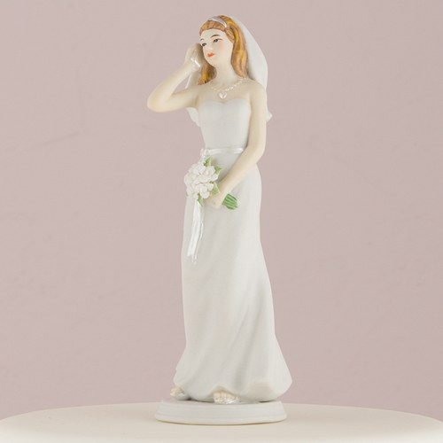 cake topper of bride on her mobile phone