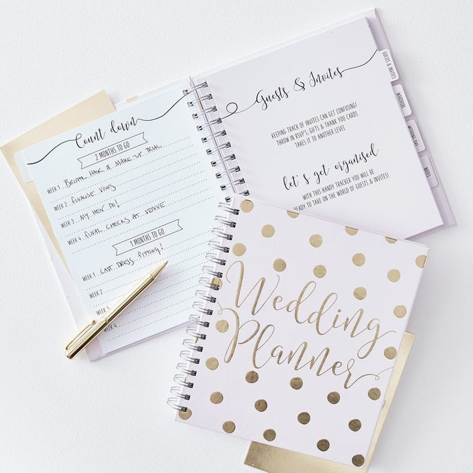 Beautiful pink and gold foiled complete wedding planner,