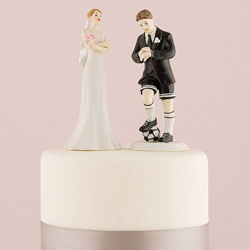 groom cake topper playing soccer and annoyed bride