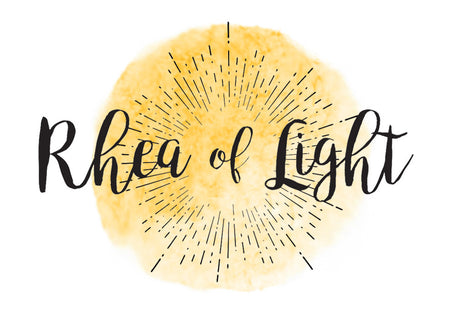 this is the logo for my company Rhea of Light with a circular yellow water color image in the background