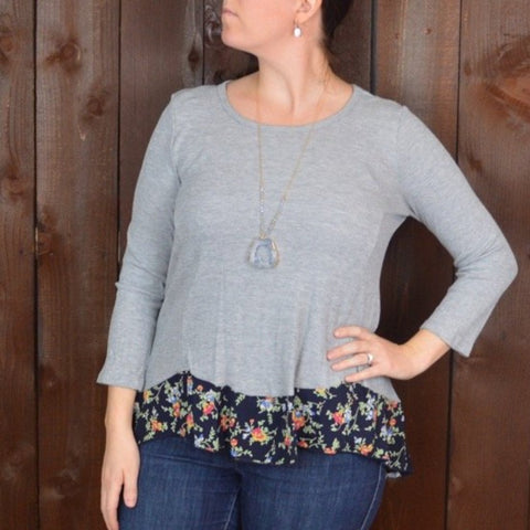 GREY TOP WITH BLACK PRINTED FLORAL HEM