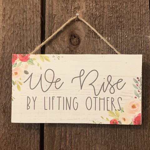 """WE RISE"" PETITE WOOD HANGING SIGN"