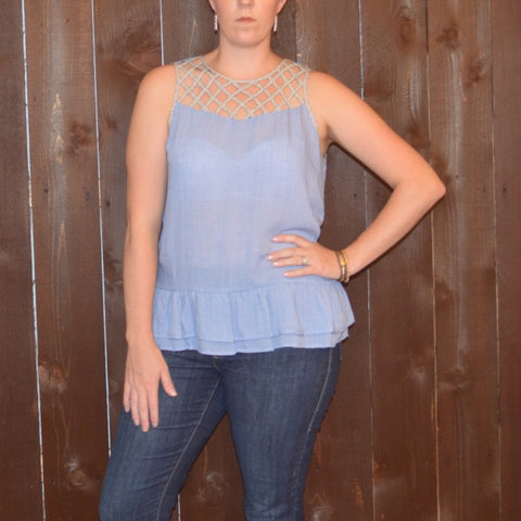 SLEEVELESS CRISS CROSS TOP WITH RUFFLED HEM