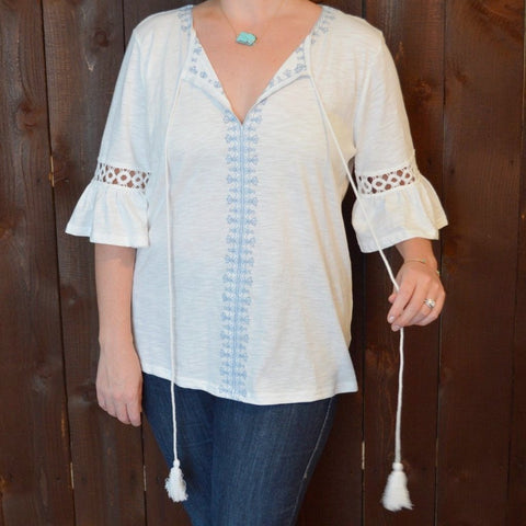WHITE TOP WITH EMBROIDERY AND BELL SLEEVES