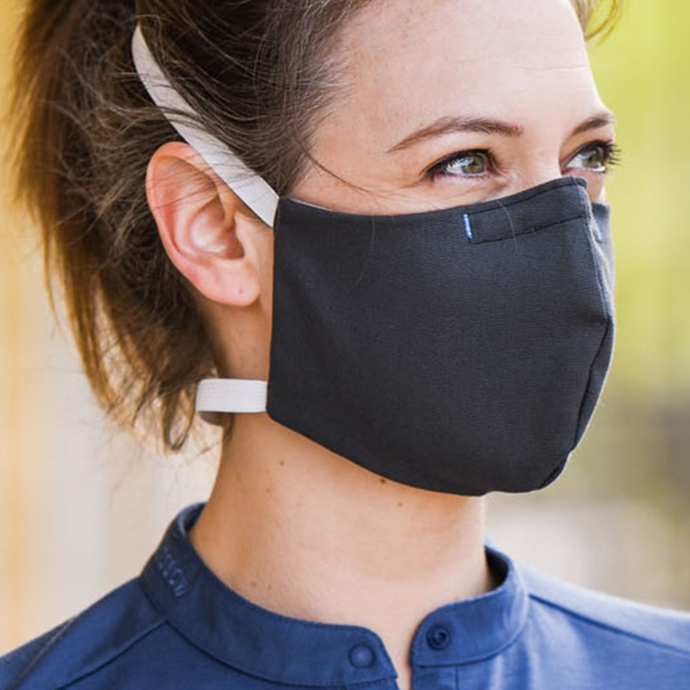 Woman wearing Kitsbow Face Mask, Reusable, HEPA Type Dark Sea