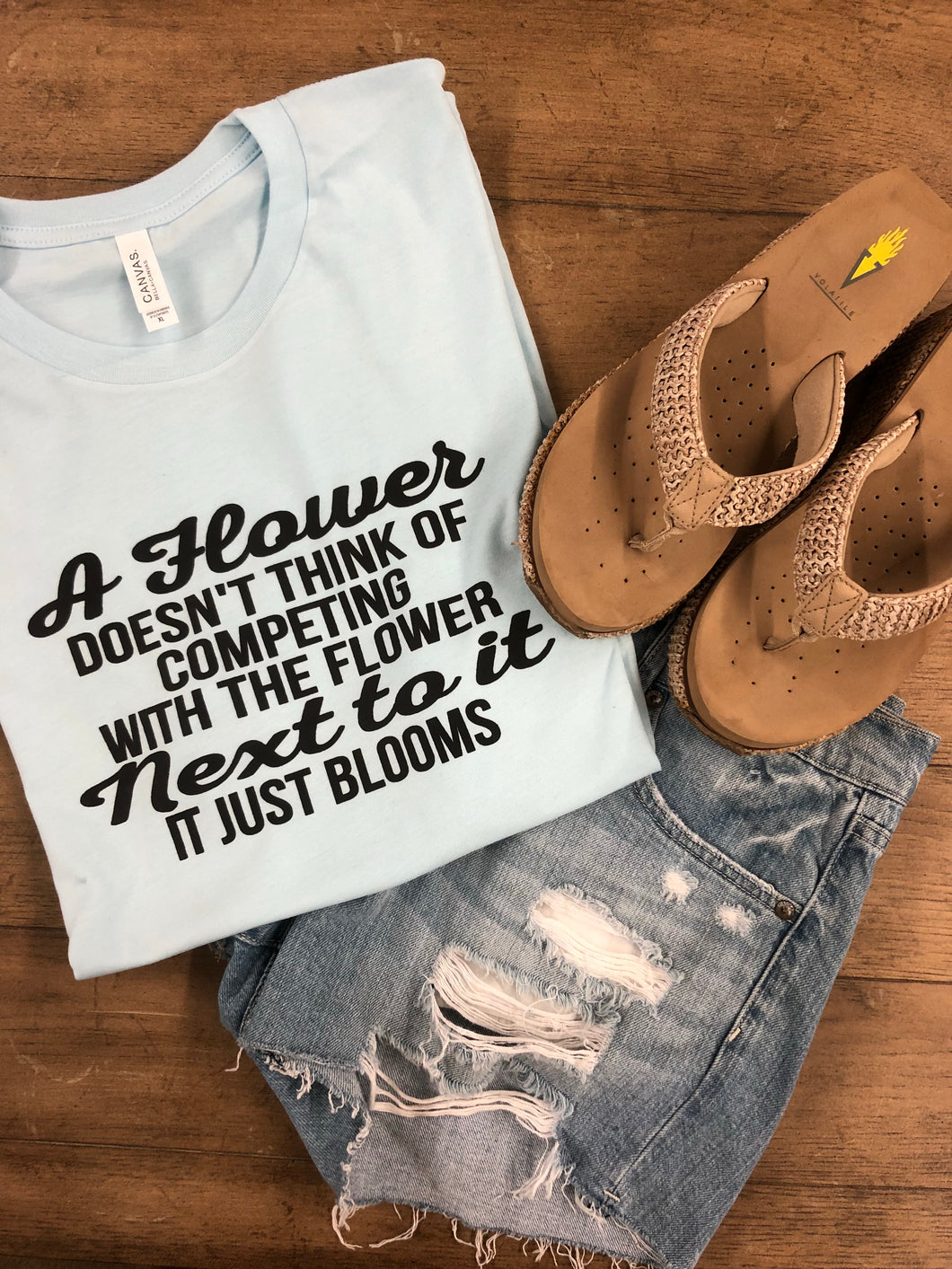 A flower doesn't compete tee