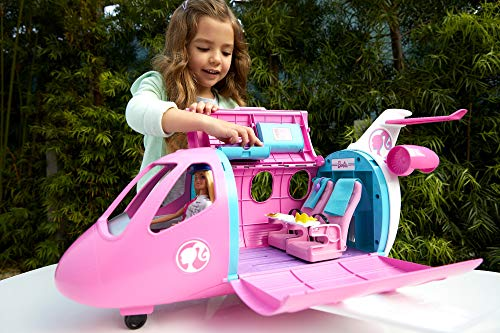 Barbie - Dreamplane Doll and Playset - Child playing with plane