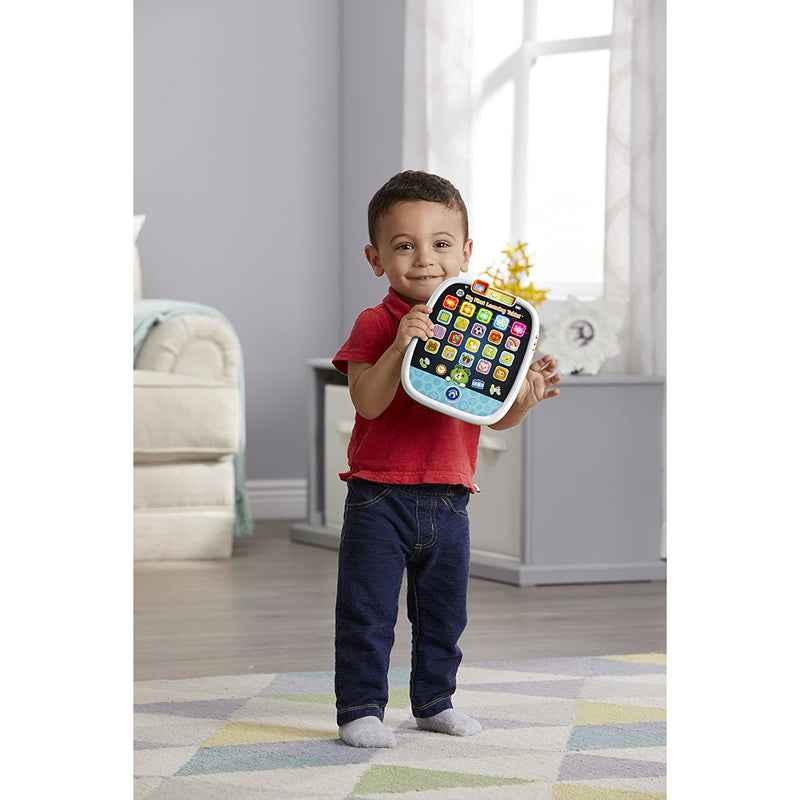 Child holding LeapFrog My First Learning Tablet