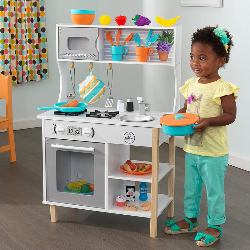KidKraft All Time Play Kitchen with accessories and child