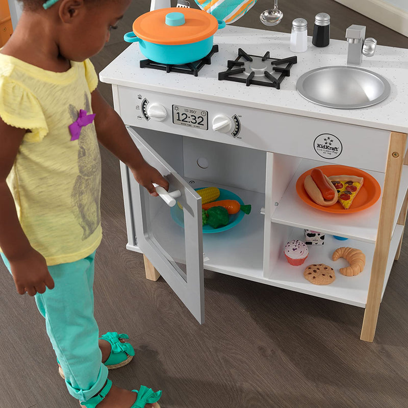 KidKraft All Time Play Kitchen child opening oven