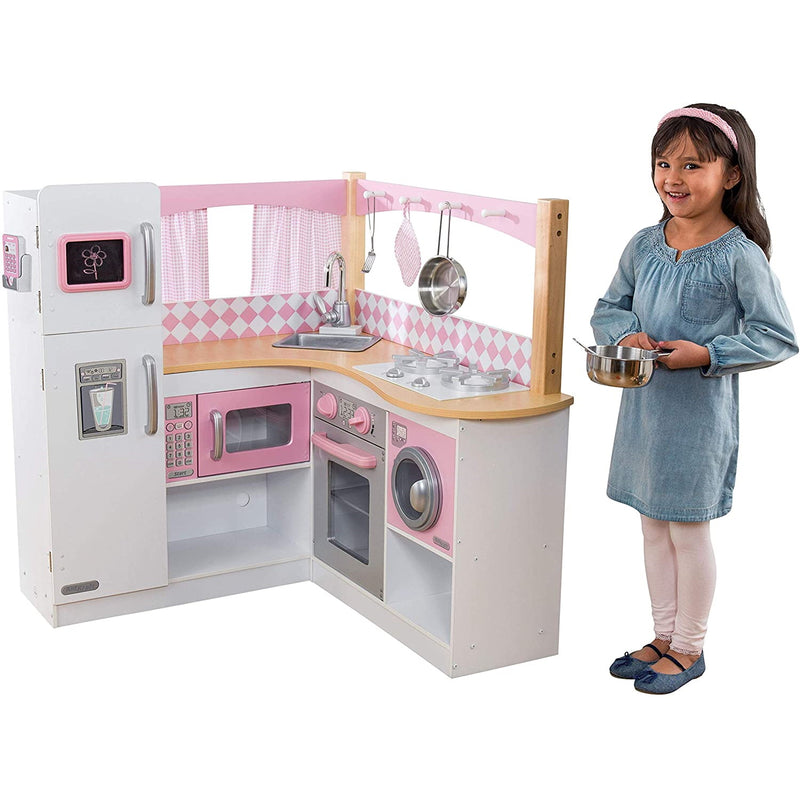 KidKraft Grand Gourmet Corner Kitchen with child playing
