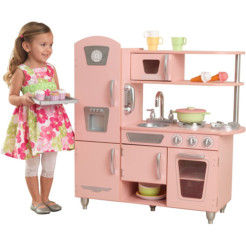 KidKraft Pink Vintage Kitchen with child playing