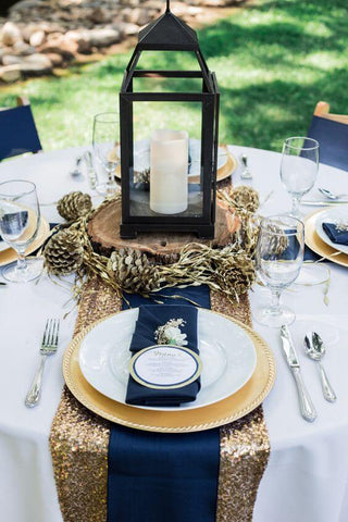 Gold sequin runner, navy napkins, and white tablecloth