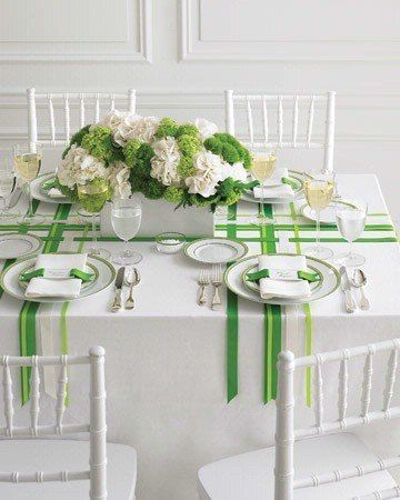 Three white/green striped table runners placed lengthwise and widthwise