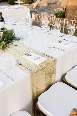 Gold Table Runner atop a White Tablecloth