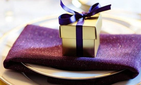 Gold Favor Box with a Purple Ribbon