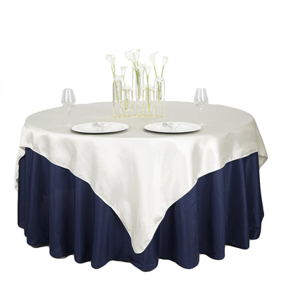"72"" x 72"" Ivory Seamless Satin Square Tablecloth Overlay"