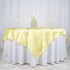 72 Inch x 72 Inch | Yellow Seamless Satin Square Tablecloth Overlay | TableclothsFactory