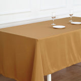 "72""x120"" Gold Polyester Rectangular Tablecloth"