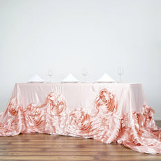 "90""x156"" Rose Gold/Blush Large Rosette Oblong Rectangular Lamour Satin Tablecloth"