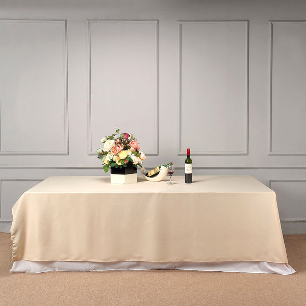 "90""x132"" Beige Polyester Rectangular Tablecloth"