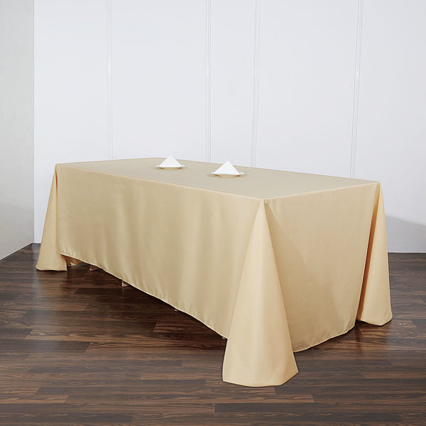 "90""x132"" Champagne Polyester Rectangular Tablecloth"
