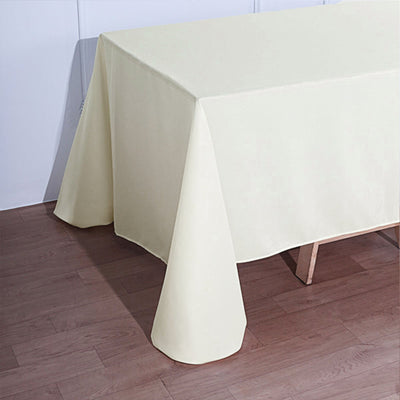 90 Inch x132 Inch | Ivory Polyester Rectangular Tablecloth | TableclothsFactory