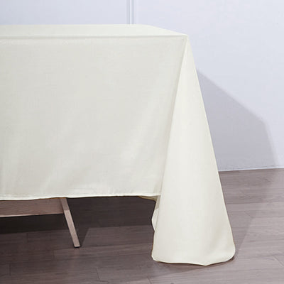 "90x132"" Ivory Polyester Rectangular Tablecloth"