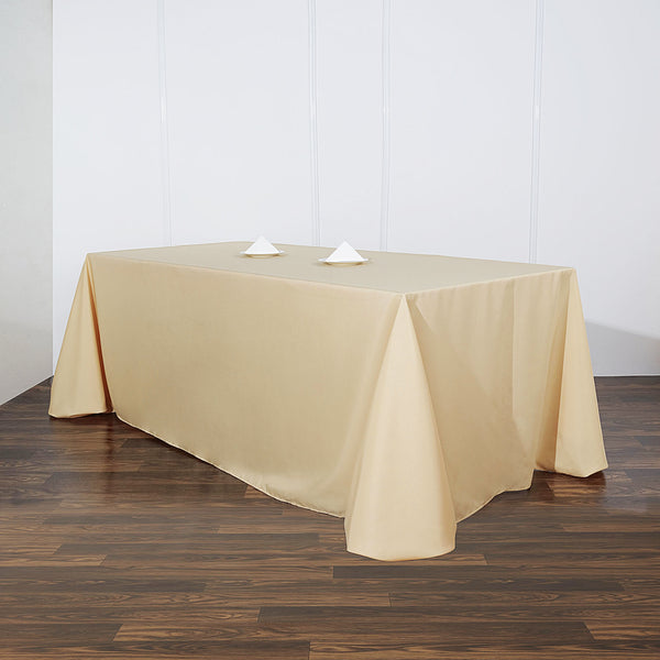 "90""x156"" Champagne Polyester Rectangular Tablecloth"