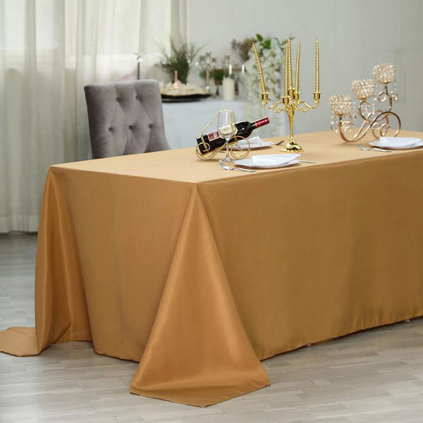 "90""x156"" Gold Polyester Rectangular Tablecloth"