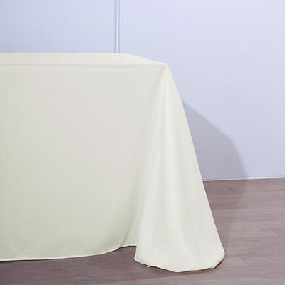 90 Inch x 156 Inch | Ivory Polyester Rectangular Tablecloth | TableclothsFactory